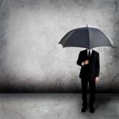 12044949-uomo-d-39-affari-con-un-ombrello
